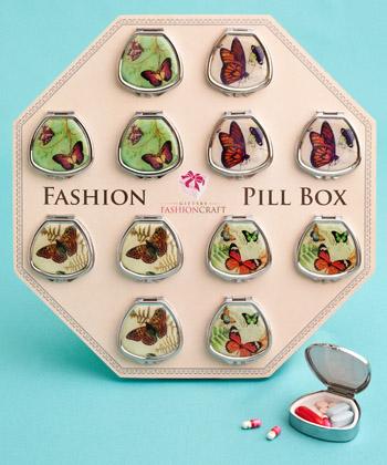Fan-shaped pill boxes in pretty butterfly designs-Fan-shaped pill boxes in pretty butterfly designs