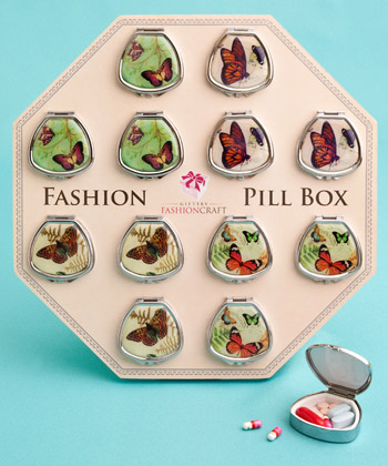 Fan-shaped pill boxes in pretty butterfly designs-Fan-shaped pill boxes in pretty butterfly designs